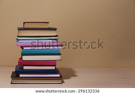 Stack of books on shelf. #296132336