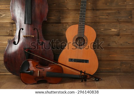 Musical instruments on wooden planks background Royalty-Free Stock Photo #296140838
