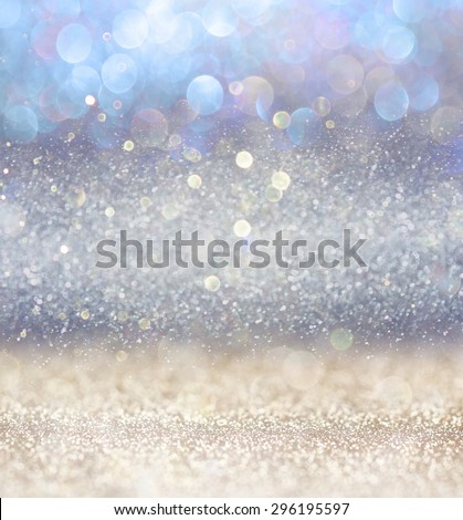 glitter vintage lights background with light burst . silver, blue and white. de-focused.  #296195597