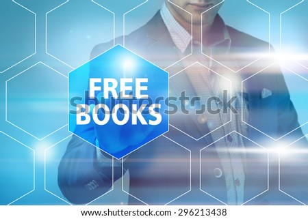 Businessman pressing free books button on virtual screens. Business, technology, internet and networking concept