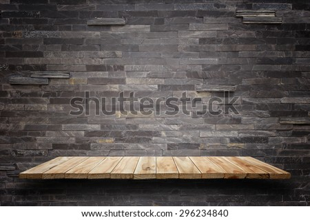 Empty top wooden shelves and stone wall background. For product display