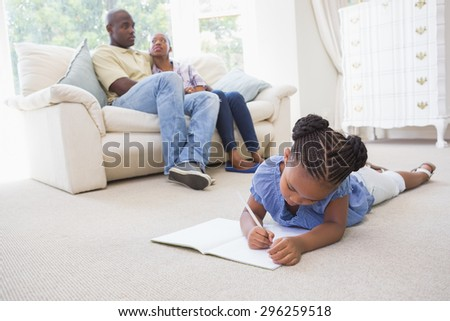 Happy family at home in the living room #296259518