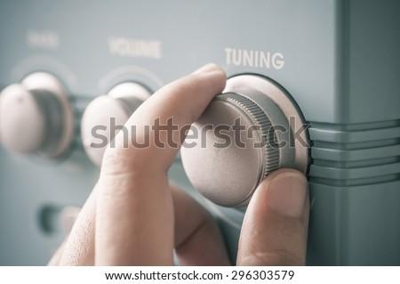 Hand tuning fm radio button. Retro image processed. #296303579