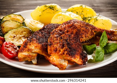 Barbecued chicken leg with boiled potatoes and vegetables  #296314241