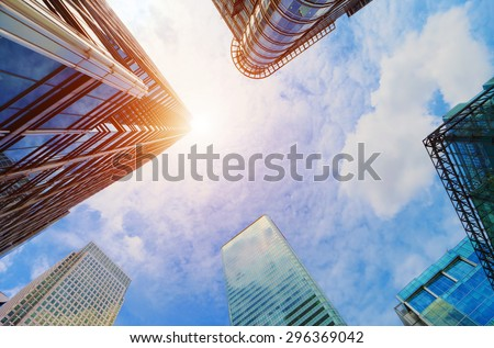 Common modern business skyscrapers, high-rise buildings, architecture raising to the sky, sun. Concepts of financial, economics, future etc. Royalty-Free Stock Photo #296369042