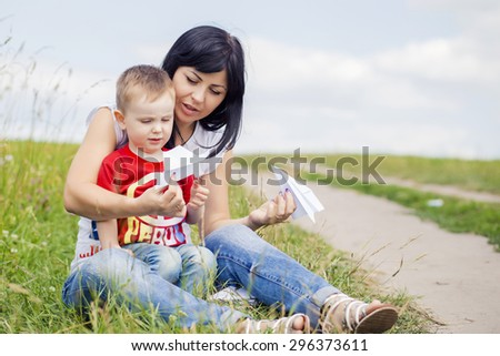 Mother and her child play outdoors #296373611