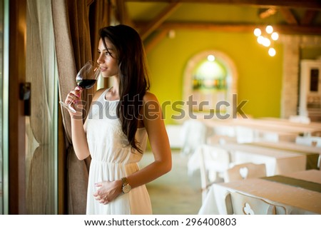 Young woman with glass of red wine #296400803