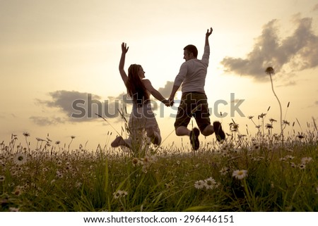 A Young couple in love outdoor at the sunset #296446151