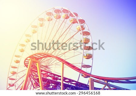 Vintage toned picture of an amusement park. #296456168