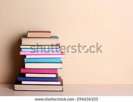 Stack of books on shelf. #296636105