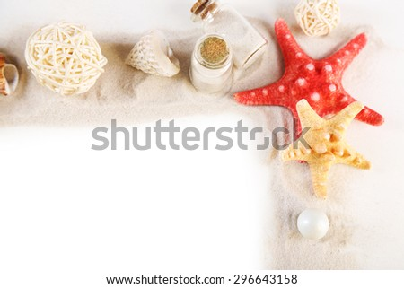Frame of collection of seashells and sand isolated on white #296643158