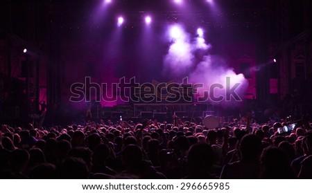 Bontida, Romania - JUNE 27, 2015: Audience having fun during concert at Electric Castle festival, one of the biggest music festivals in Romania #296665985