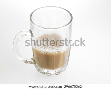 Half glass of Tea with milk or Teh Tarik in Malaysia #296670362