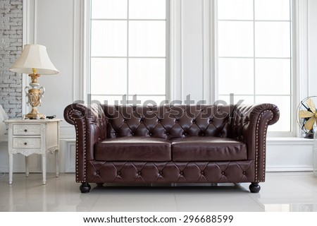 vintage style of interior decoration the leather sofa in white room #296688599