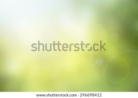 Abstract green nature blurred background with bright sunlight, flare and bokeh effect, blurry gradient backdrop for design element or presentation template in environment friendly concepts
