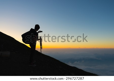 Hikers gather during sunrise on the Mt. Fuji summit. #296727287