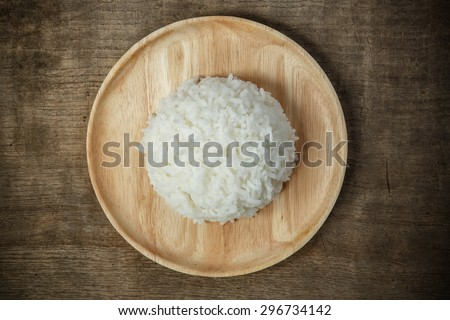 Top view hot cooked rice on wooden dish. #296734142