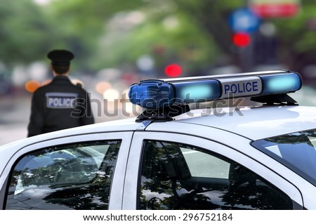 Police officer emergency service car driving street with siren light blinking