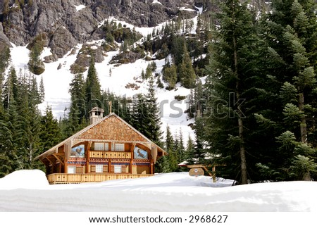 Ski Chalet at foothill of high mountain