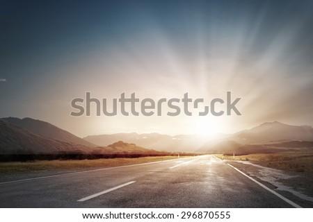Picturesque landscape scene and sunrise above road #296870555