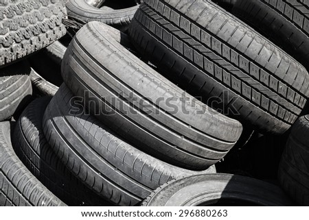 Heap of old used worn-out automotive tires #296880263