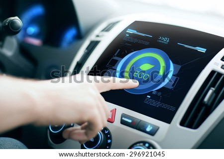 transport, modern, green energy, technology and people concept - male hand using car eco system mode #296921045