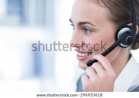 Close up view of happy businesswoman with headset in call center #296933618