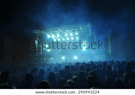 BONTIDA, ROMANIA - JUNE 28, 2015: Crowd of partying people at Electric Castle festival, one of the biggest music festivals in Romania. #296943224