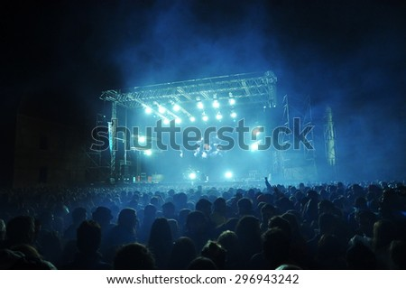 BONTIDA, ROMANIA - JUNE 28, 2015: Crowd of partying people at Electric Castle festival, one of the biggest music festivals in Romania. #296943242