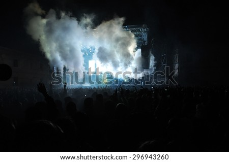 BONTIDA, ROMANIA - JUNE 28, 2015: Crowd of partying people at Electric Castle festival, one of the biggest music festivals in Romania. #296943260