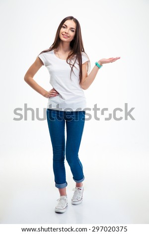 Full length portrait of a smiling woman holding copyspace on the palm isolated on a white background. Looking at camera Royalty-Free Stock Photo #297020375