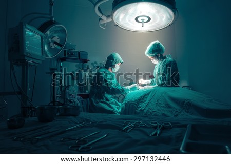 Surgeons team working with Monitoring of patient in surgical operating room. Royalty-Free Stock Photo #297132446