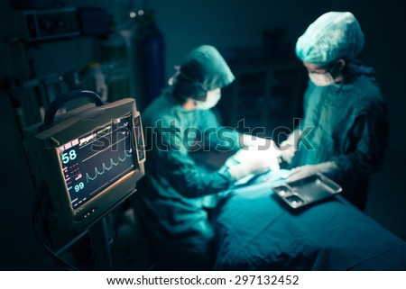 Surgeons team working with Monitoring of patient in surgical operating room. selective focus on Monitor. #297132452