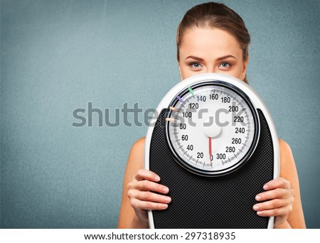 Dieting, Exercising, Women. Royalty-Free Stock Photo #297318935