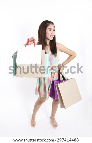 Shopping woman holding bags, isolated on white studio background #297414488