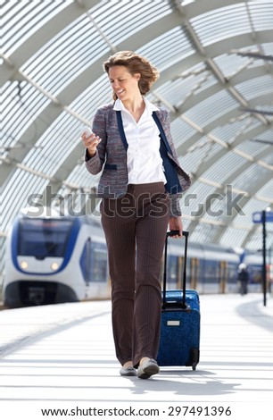 Full body portrait of a traveling business at train station #297491396