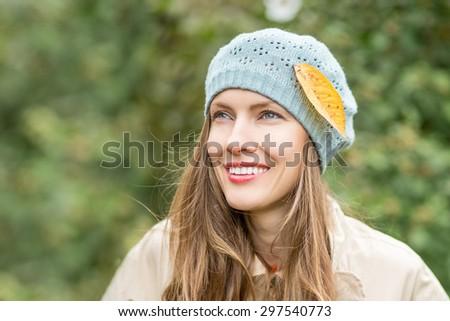 Beautiful autumn woman walking in park in early autumn #297540773