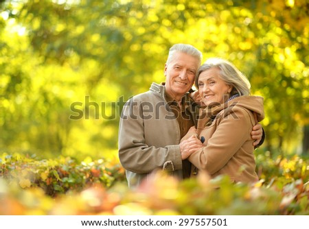 Happy senior couple relaxing in autumn park #297557501