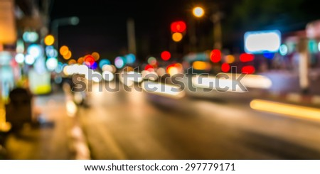 image of blur street  bokeh  with warm colorful lights in night time for background usage . #297779171