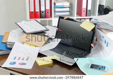 View of a untidy and cluttered desk Royalty-Free Stock Photo #297886847