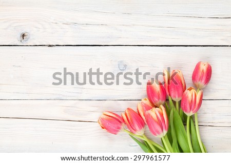 Colorful tulips on wooden table. Top view with copy space #297961577
