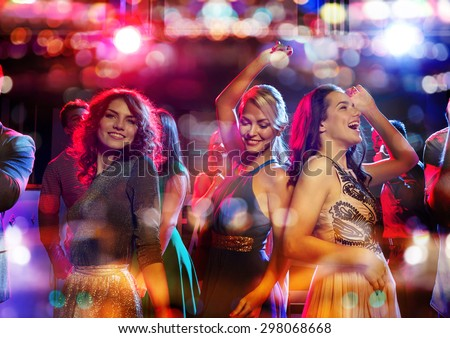 party, holidays, celebration, nightlife and people concept - happy friends dancing in club with holidays lights #298068668
