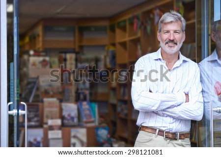 Portrait Of Male Bookshop Owner Outside Store Royalty-Free Stock Photo #298121081