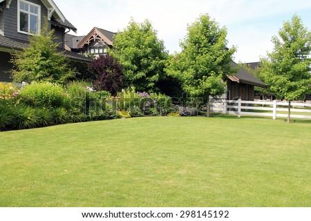 Perennial flower summer garden, in a front yard.  #298145192