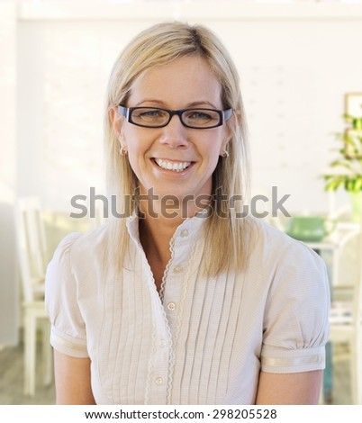 Portrait of middle-aged woman smiling happy, looking at camera. #298205528