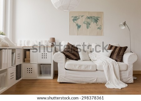 White sofa and commode in cozy living room #298378361