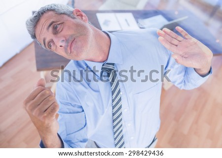 A serious businessman lifting something in office #298429436