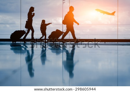 Silhouette of young family and airplane Royalty-Free Stock Photo #298605944