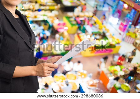 Businesswoman reading a business document. #298680086