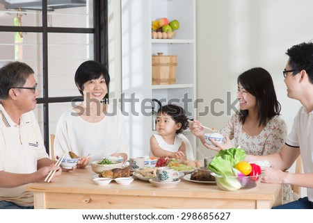 Happy Asian Chinese multi generations family dining at home. Eating with chopsticks. #298685627